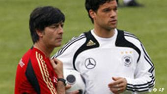 Michael Ballack stands next to Joachim Loew on sidelines