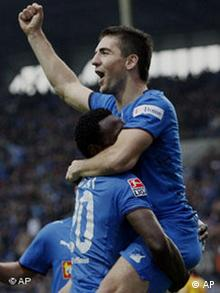 Chinedu Ogbuke Obasi from Hoffenheim, left, celebrates team mate Vedad Ibisevic, right, scoring the opening goal during the German first division Bundesliga soccer match between 1899 Hoffenheim and Karlsruher SC in Mannheim, southwestern Germany, on Saturday, Nov. 1, 2008. (AP Photo/Daniel Roland) ** NO MOBILE USE UNTIL 2 HOURS AFTER THE MATCH, WEBSITE USERS ARE OBLIGED TO COMPLY WITH DFL-RESTRICTIONS, SEE INSTRUCTIONS FOR DETAILS **