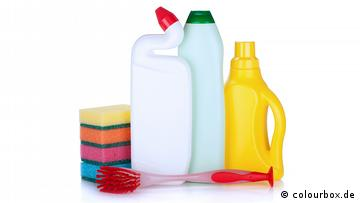 Bottles of detergent, a sponge and a brush
