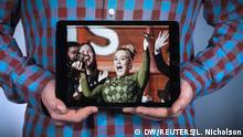 16.02.2017 - Deutsche Welle Ein Foto mit Sängerin Adele, die einen Grammy zerbricht, auf einem Tablet-PC, den Sertan Sanderson in Händen hält