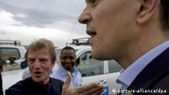 Kouchner, left, and Miliband during a tour of the Kibati refugee camp near Goma