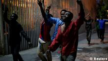 17.02.2017 +++ African migrants react as they arrive at the CETI, the short-stay immigrant centre, after crossing the border from Morocco to Spain's North African enclave of Ceuta, Spain, February 17, 2017. REUTERS/Jesus Moron FOR EDITORIAL USE ONLY. NO RESALES. NO ARCHIVES