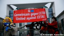 17.02.2017*****Demonstrators, protesting against the Comprehensive Economic Trade Agreement (CETA), hold a banner ahead of Canada's Prime Minister Justin Trudeau visit outside the Chancellery in Berlin, Germany, February 17, 2017. REUTERS/Hannibal Hanschke