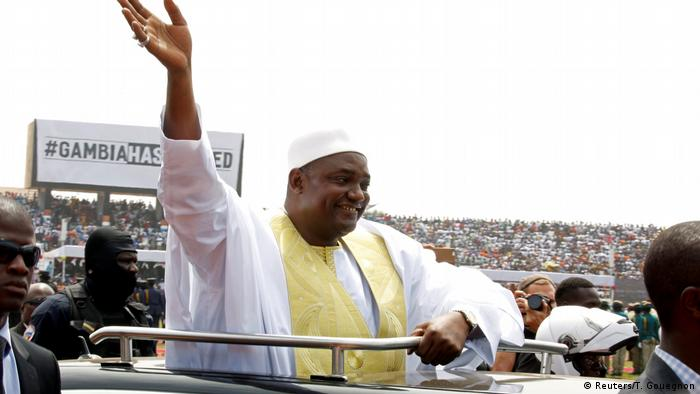 Gambian President Adama Barrow waves to the crowd during his swearing in ceremony