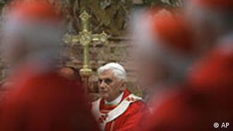 Pope Benedict XVI is framed by cardinals during a Mass for cardinals and bishops deceased over the year, inside St. Peter's Basilica, at the Vatican