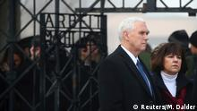 U.S. Vice President Mike Pence and his wife Karen arrive at the gate of the former German Nazi concentration camp in Dachau near Munich, Germany February 19, 2017. REUTERS/Michael Dalder