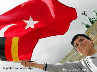 Boy waves German and turkish flags