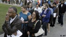 Early voters, including Khalil Abdul-Aziz, left, wait to cast their ballots Monday, Nov. 3, 2008, in the general election at the Los Angeles County Registrar-Recorder/County Clerk's office in Norwalk, Calif. (AP Photo/Ric Francis)