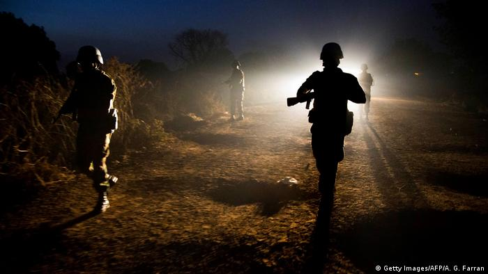 UN troops patrolling at night. (Getty Images/AFP/A. G. Farran)