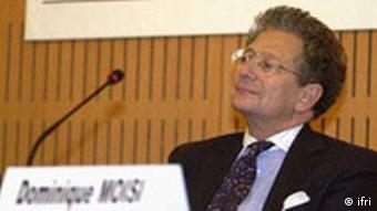 Dominique Moisi of France's Institute for International Relations sitting in front of a microphone