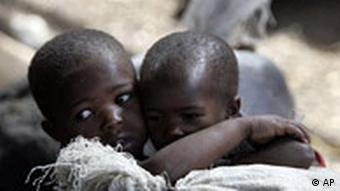 Two boys hug each other in a refugee camp in Goma