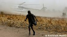 18.02.2017**** A boy moves away as a United Nations World Food Programme (WFP) helicopter lands in Rubkuai village, Unity State, northern South Sudan, February 18, 2017. Picture taken February 18, 2017. REUTERS/Siegfried Modola TPX IMAGES OF THE DAY