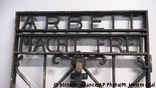 FILE - In this Dec. 3, 2016 file picture the iron gate from the former Nazi concentration camp in Dachau, southern Germany, with the slogan Arbeit macht frei (Work will set you free) is displayed after being found by police in Bergen, Norway. The gate was stolen two years ago and found in Norway in Dec. 2016. It will be transported to Germany Monday Jan. 30, 2017, German news agency dpa reported Friday Jan. 27, 2017. (Marit Hommedal / NTB scanpix via AP,file) |