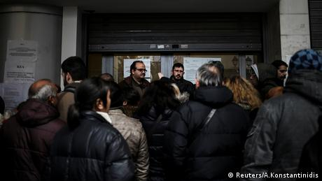 People line up to apply for social benefit in Athens