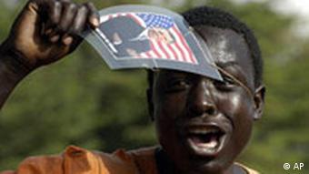 An unidentified Kenyan in Kisumu, Western Kenya, Wednesday Nov. 5, 2008, celebrates the victory of Barack Obama in the American presidential election