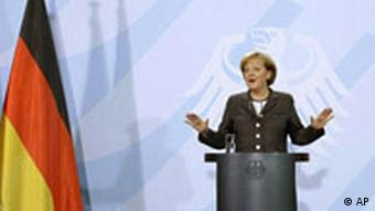 German Chancellor Angela Merkel delivers a statement in Berlin, Germany, Wednesday, Nov. 5, 2008 on the victory of Barack Obama