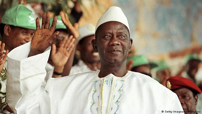 Former Guinea President Lansana Conté waves to supporters