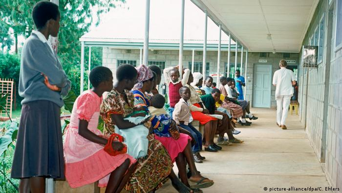 Patients waiting in line to see the doctor in front of a Kenyan hospital.