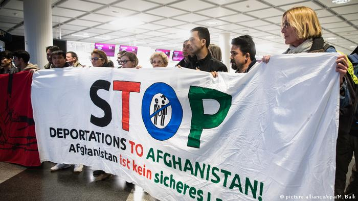 Protesters with a banner saying Stop Deportations to Afghanistan at the airport in Munich (picture alliance/dpa/M. Balk)