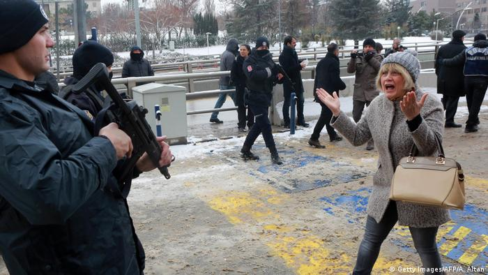 Demonstrator in Turkey faces armed soldier