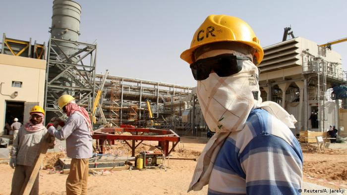 Workers at Khurais oilfield in Saudi Arabia
