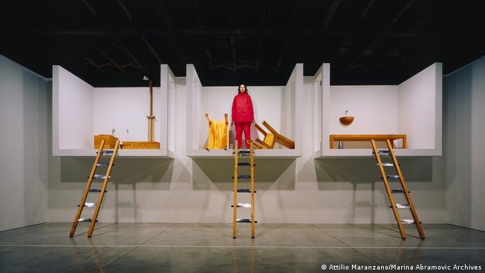 Marina Abramovic stands in the middle of her installation The House with The Ocean View. Ladders are leading up to each of the three rooms. (Attilio Maranzano/Marina Abramovic Archives)
