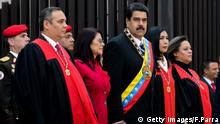 (L-R) Venezuelan Supreme Court First Vice-President Maikel Moreno, First Lady and deputy Cilia Flores, Venezuelan President Nicolas Maduro, the President of the Supreme Court of Justice Gladys Maria Gutierrez and Supreme Court Second Vice-President Indira Alfonzo, receive military honors upon their arrival at the Supreme Court in Caracas on January 29, 2016. AFP PHOTO/FEDERICO PARRA / AFP / FEDERICO PARRA (Photo credit should read FEDERICO PARRA/AFP/Getty Images)