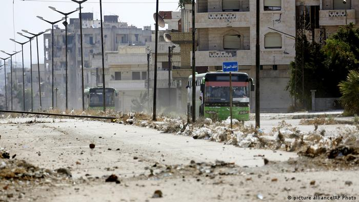 Syrian government buses evacuate residents from Homs