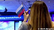 A lady holds the Russian flag with the word Trump on it at CPAC2017 (DW/M.Shwayder)