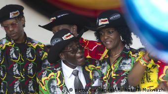 Robert Mugabe and his wife Grace at the former Zimbabwean president's 93rd birthday party on the outskirts of Bulawayo, Saturday, Feb. 25, 2017. (AP Photo/Tsvangirayi Mukwazhi)