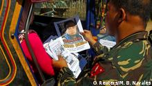 February 1, 2017*** Soldiers distribute pictures of a member of extremist group Abu Sayyaf Isnilon Hapilon, who has a U.S. government bounty of $5 million for his capture, in Butig, Lanao del Sur in southern Philippines February 1, 2017. Picture taken February 1, 2017. REUTERS/Marconi B. Navales