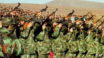 KLA soldiers firing a salute for a dead comrade