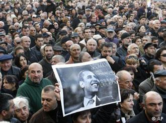 Protesters hold a poster of US President-elect Obama, reading America We Believe In, at the Friday protest in Tbilisi