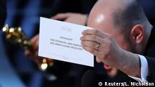 26.02.2017+++ 89th Academy Awards - Oscars Awards Show - Producer Jordon Horowitz holds up the card for the Best Picture winner Moonlight. REUTERS/Lucy Nicholson