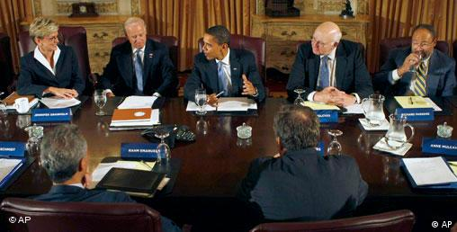 Obama, center, meets with his economic advisory team in Chicago, Friday, Nov. 7, 2008. Facing camera, from left are, Michigan Gov. Jennifer Granholm, Vice President-elect Joe Biden, former Federal Reserve Chairman Paul Volcker and Time Warner Chairman Richard Parsons. Back to camera, from left are, White House Chief of Staff-designate Rahm Emanual and Google CEO Eric Schmidt. (AP Photo/Pablo Martinez Monsivais)