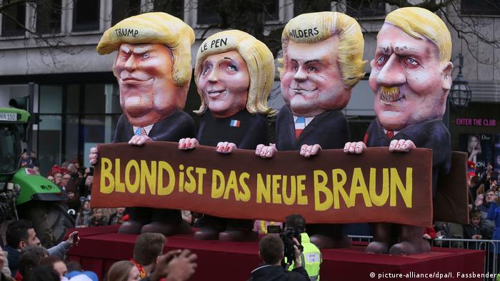 Адольф Гитлер, Дональд Трамп, Марин Ле Пен и Герт Вилдерс держат плакат с надписью: Коричневый цвет теперь сменил цвет блонд.