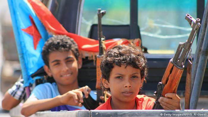 rmed Yemeni children sit in the back of a pick up truck with fighters loyal to Yemen's Saudi-backed government