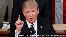28.02.2017 President Donald Trump addresses a joint session of Congress on Capitol Hill in Washington, Tuesday, Feb. 28, 2017, as Vice President Mike Pence listens. (AP Photo/Pablo Martinez Monsivais)