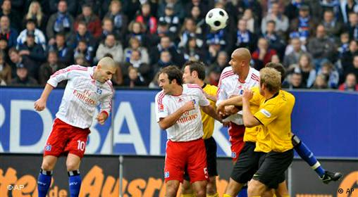 Hamburg's Mladen Petric, left, scores his side's first goal during the German first division Bundesliga soccer match between Hamburger SV and Borussia Dortmund in Hamburg, Germany, Saturday, Nov. 8, 2008.
