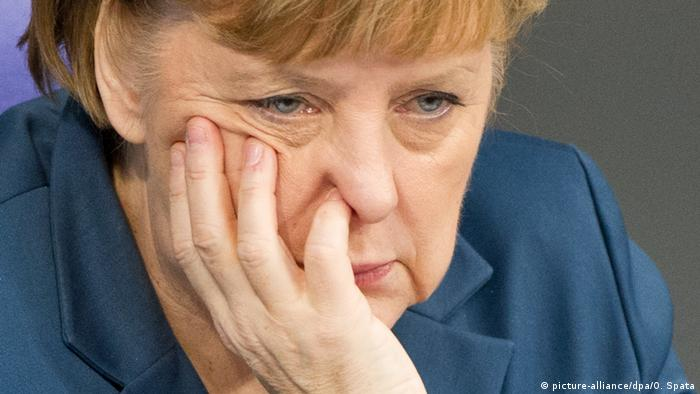 Chancellor Angela Merkel following a 2013 meeting of the German Bundestag in Berlin (picture-alliance/dpa/O. Spata)
