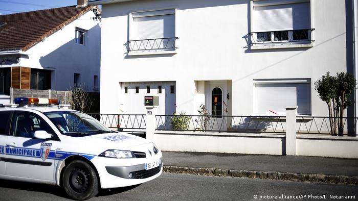 A police car parked outside the house belonging to the missing Troadec family in Orvault
