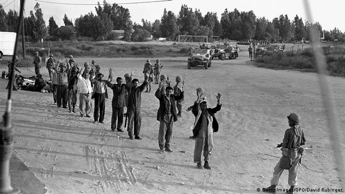 Israeli troops guard captured Egyptians and Palestinains