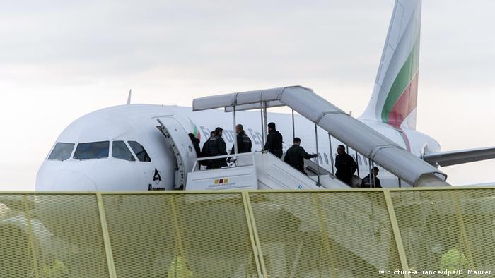 Failed Afghan asylum seekers board a plane that will take them back to Afghanistan