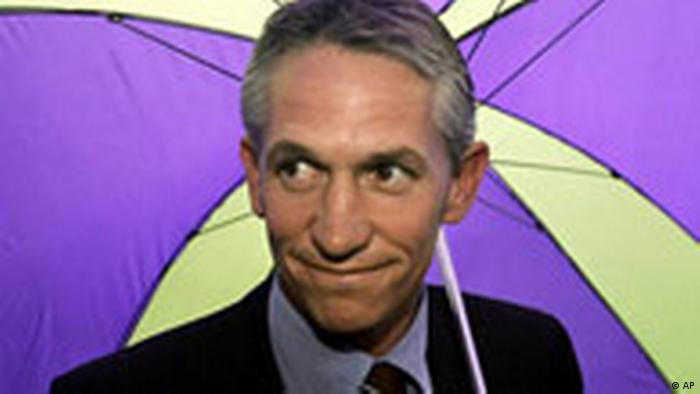 Former player for England and BBC Sports reporter Gary Lineker holding a colorful umbrella (AP)