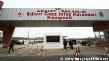 Turkish soldiers stand guard at the entrance of the Silivri district prison in Istanbul, as they prepare for the Ergenekon trial on October 19, 2008. Turkish court will on October 20, 2008 begin hearing a case against 86 people accused of membership in an armed shadowy group that plotted to overthrow Turkey's Islamist-rooted government in a trial that has sharpened political divisions.The trial will be held in a special hall at a prison complex (Silivri Prison) near Istanbul because of the large number of defendants. Court sources say the opening hearing could last days and even weeks depending on whether the court orders the reading out of the bulky indictment. AFP PHOTO / MUSTAFA OZER (Photo credit should read MUSTAFA OZER/AFP/Getty Images)