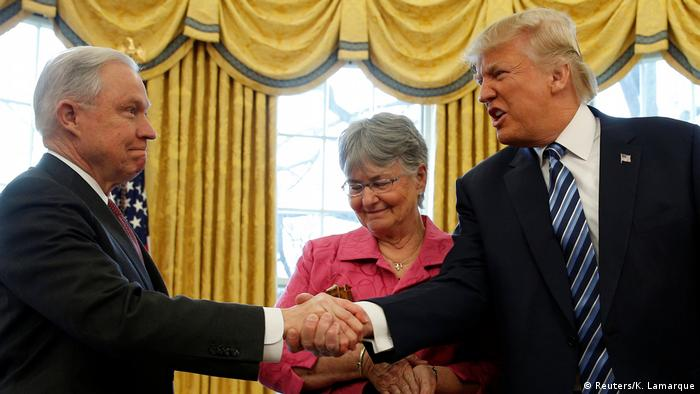 US President Donald Trump congratulates Jeff Sessions after he was sworn in as Attorney General, February 9, 2017.
