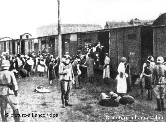 Jews from Warsaw are packed onto trains headed for the Treblinka death camp