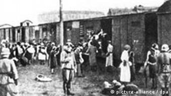 Jews being taken from the Warsaw ghetto and transported to Treblinka