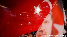 February 18, 2017 People wave with flags showing Turkish President Recep Tayyip Erdogan before Turkish Prime Minister Binali Yildirim is expected to address a crowd of around 10,000 in Oberhausen, Germany, February 18, 2017, to promote Turkey's constitution referendum on April 16, 2017. REUTERS/Wolfgang Rattay TPX IMAGES OF THE DAY