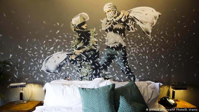 A pillow fight on the wall of one of the hotel rooms designed by Banksy